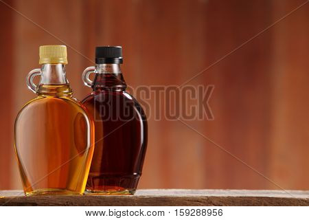 bottle of syrup on the wooden background