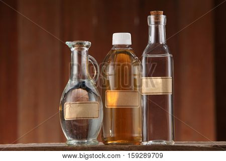 apple cider vinegar and white vinegar on the wooden background