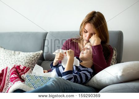 Young Mother, Holding Her Little Sick Boy