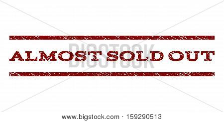 Almost Sold Out watermark stamp. Text tag between horizontal parallel lines with grunge design style. Rubber seal dark red stamp with unclean texture. Vector ink imprint on a white background.