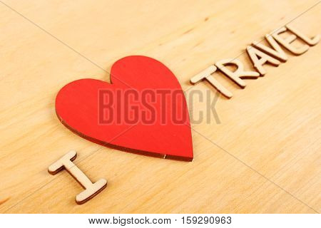 Closeup on wooden background wooden text I love Travel
