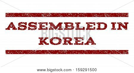 Assembled In Korea watermark stamp. Text tag between horizontal parallel lines with grunge design style. Rubber seal dark red stamp with scratched texture. Vector ink imprint on a white background.