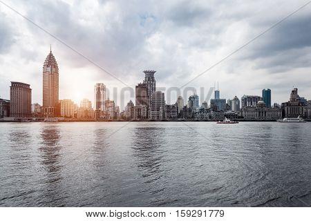 the bund of shanghai and huangpu river at dusk