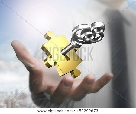 Man Hand Showing Golden Puzzle Piece With Silver Key