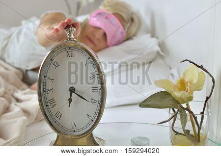 Alarm Clock And Awake Woman