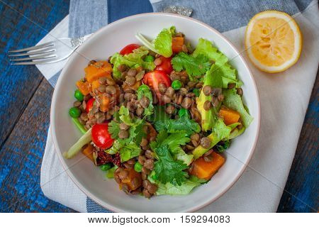 Salad with baked sweet potatoes avocados lentils dried tomatoes cilantro pumpkin seeds and oil. . Perfect for the detox diet or just a healthy meal. Love for a healthy raw food concept.