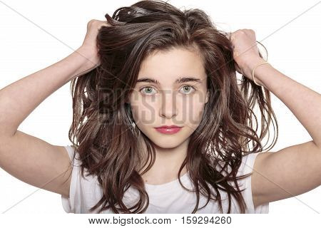 Portrait Of A Teenage Girl Who Is Pulling Her Hair Out