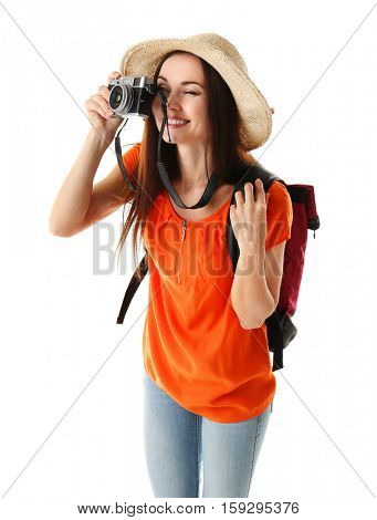 Young beautiful woman with camera on white background