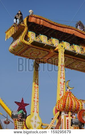 Funny flying carpet in a luna Park