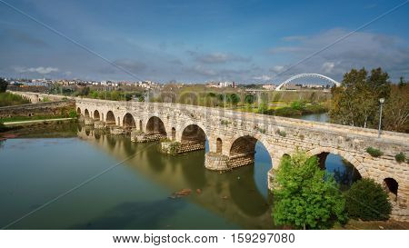Wide angle view of Roman bridge over Guadiana river in Merida, Spain