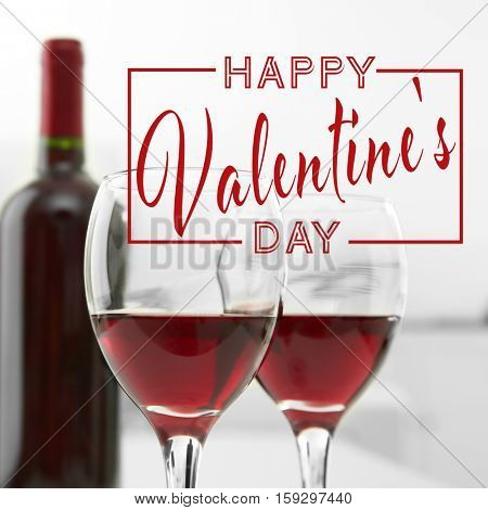 Text HAPPY VALENTINE'S DAY. Glasses of red wine, closeup