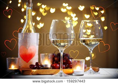 Glasses and bottle of wine on table. Valentine's day celebration concept.