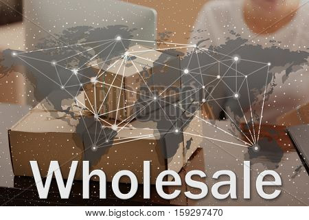 World map and word WHOLESALE on background. Cardboard boxes at storehouse. Wholesale and logistics concept.