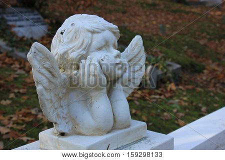 a Guardian angel grave ornament on a cemetery