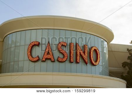 Casino sign in lights on building in daylight.