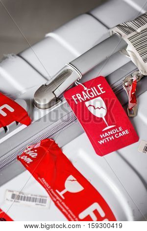 Closeup View Of Red Luggage Tag (fragile) Attached To Suitcase