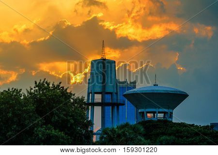 Hight Water tank with Orange sky background after sunset