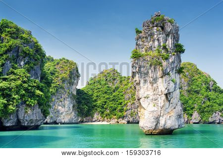 Scenic View Of Rock Pillar And Azure Water In The Ha Long Bay