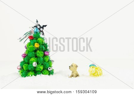 Dog and sheep looking Christmas tree isolated on white background