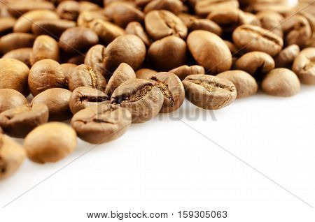 Coffee beans isolated on white background. Close-up. Soft focus.