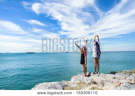 Female bystanders on beautiful beaches and blue skies.