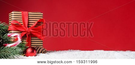 Gift box on red snowy Christmas or New Year background