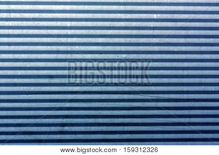 Corrugated Blue Metal Plate Surface.