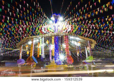 Songkran festival Buddha statue roundabout light trails