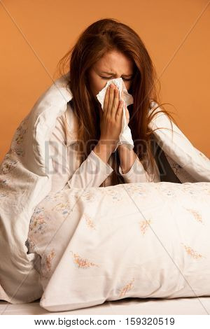 Illness Flu - Young Woman Lying On Bed Infected With Allergy Blowing Her Nose
