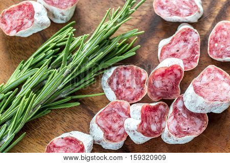 Slices of spanish salami on the wooden board