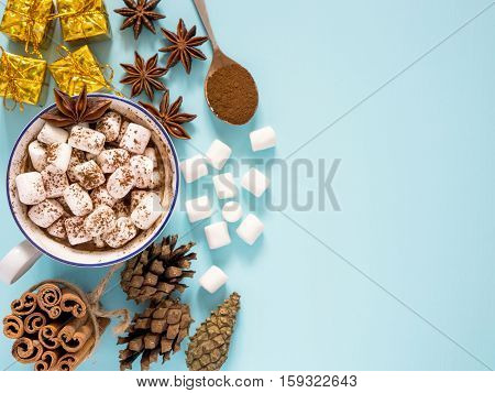 Hot Drink With Marshmallow On Blue Background