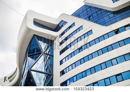 MINSK BELARUS - MAY 03 2016: Renaissance Minsk Hotel - this is the first hotel of the well-known international hotel chain Marriott in Belarus. Modern industrial building.