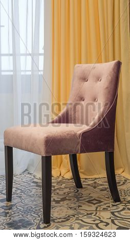 contemporary upholstered chair upholstered in fabric at the window
