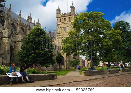 EXETER UK - July 11 2016: people in the square near the walls of the cathedral in Exeter. Devon England