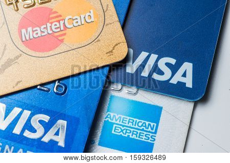 Close up of credit cards with MasterCard,Visa and American Express logos on white background,illustrative editorial