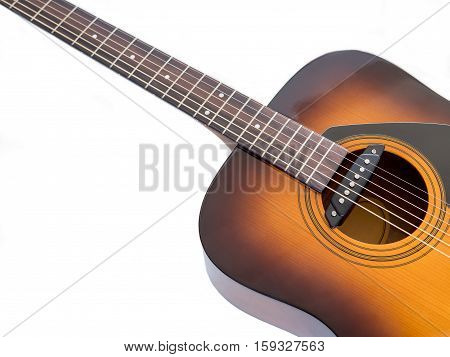 A 6-string acoustic guitar sound hole with pickup in white background selective focus