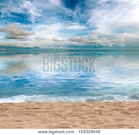 a beautiful sandy beach and the waves of the Mediterranean Sea under sunny skies