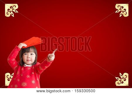 Smile Chinese woman dress traditional cheongsam and introduce on red background. asian beauty