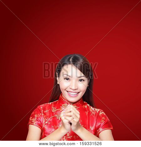 happy Chinese new year. Asian woman with gesture of congratulation isolated on red background