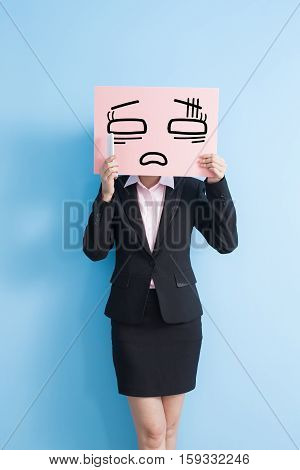 business woman take tired billboard and speak phone isolated blue background