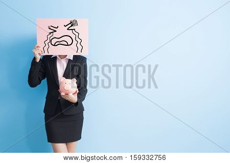 businesswoman take cry billboard and show piggy bank to you isolated with blue background