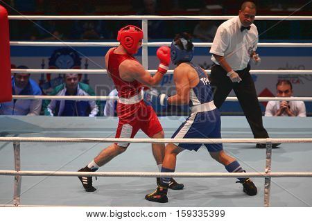 boxing uppercut right hand St. Petersburg Russia November 21 2016 AIBA Youth World Boxing Championships men heavy 81 kg. Boxing match between: RED- Rustamov S. Uzbekistan BLUE -Kan C. Taipei