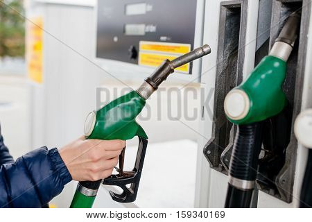 Woman Holding A Fuel Nozzle