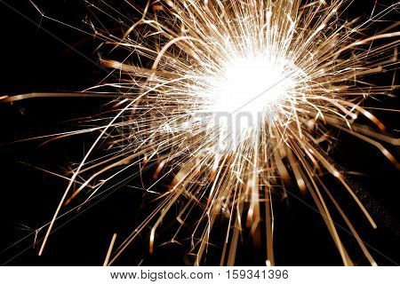 Closeup burning sparkler. Bengal light - type of hand-held firework that burns slowly while emitting flames and sparks.
