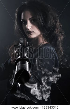 Young Woman Holding An Assault Rifle