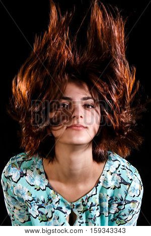 Cute Young Girl With A Blowing Hair