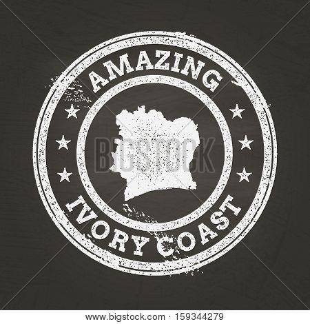 White Chalk Texture Vintage Stamp With Republic Of Ivory Coast Map On A School Blackboard. Grunge Ru