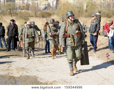 23.04.2016.Russia.Saint-Petersburg.German soldiers are in the battlefield with weapons.
