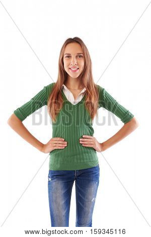 Mid portrait of happy confident girl with hands on hips looking at the camera isolated over white background in studio. Stands tall with chest out and hands on hips