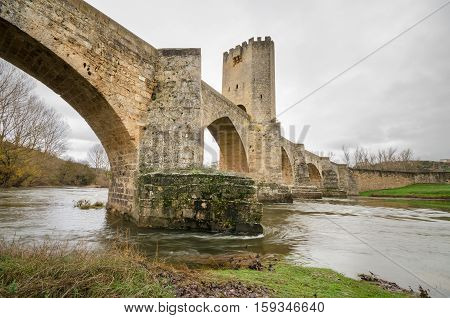 Scenic view of an ancient stone medieval bridge on a cloudy day in Frias Castilla y Leon Spain.